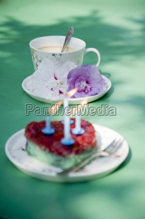 heart shaped birthday cake and coffee