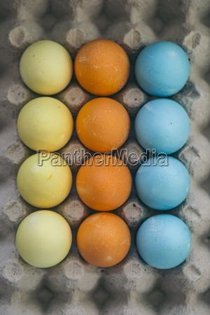 coloured eatser eggs in egg carton