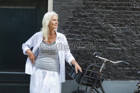 netherlands amsterdam senior woman standing with