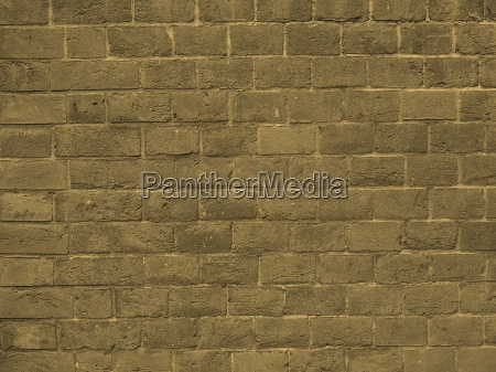red brick wall background sepia