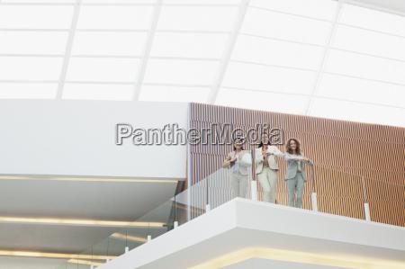 portrait of smiling businesswomen standing on