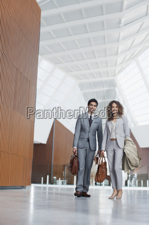 portrait of smiling businessman and businesswoman
