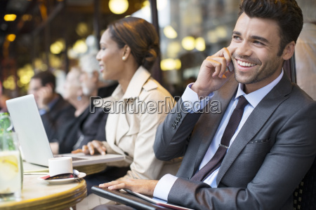 business people working at sidewalk cafe
