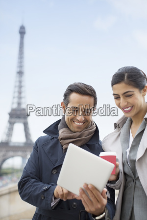 business people using digital tablet near