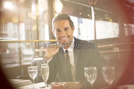 businessman smiling at restaurant