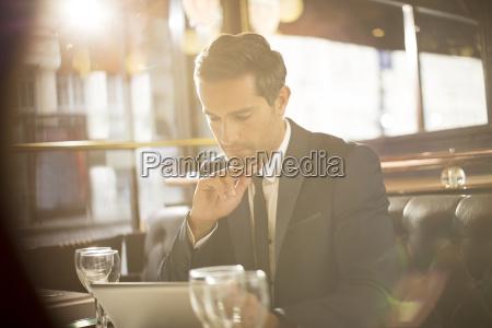 businessman using digital tablet in restaurant