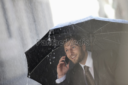 businessman talking on cell phone under