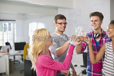 business people toasting each other with
