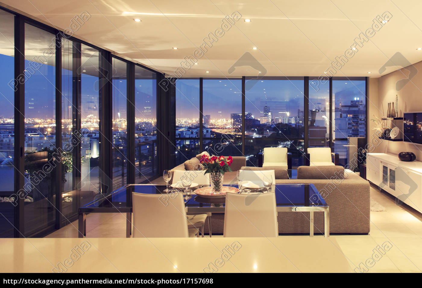 illuminated, modern, living, room, overlooking, city - 17157698