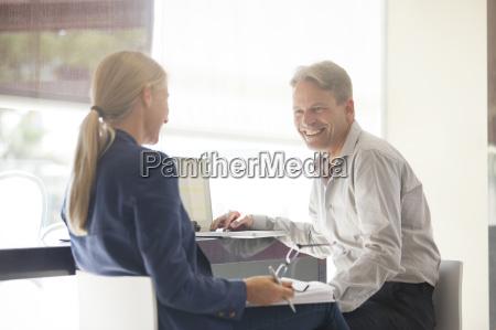 business people talking at desk