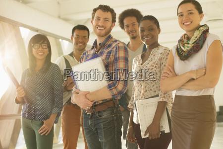 portrait of happy creative business people