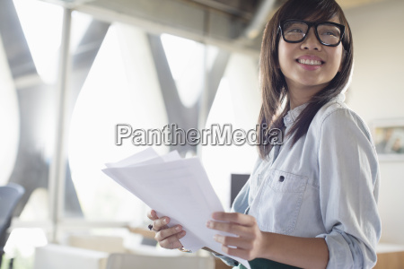 happy creative businesswoman with paperwork in