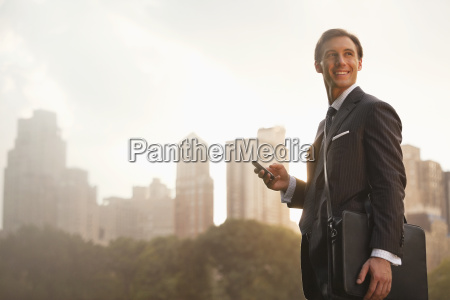 businessman using cell phone in urban