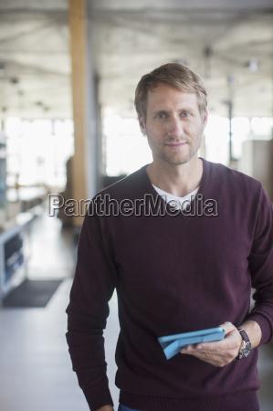 businessman holding digital tablet in office
