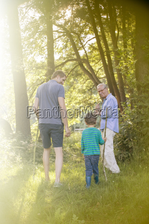 boy father and grandfather walking in