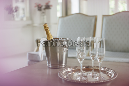 champagne in silver bucket next to