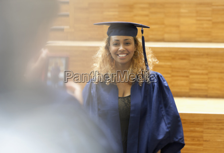 female student in graduation gown posing