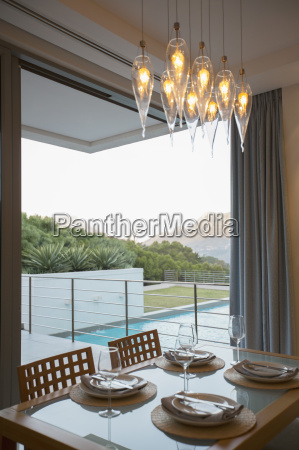 luxury dining room overlooking balcony and