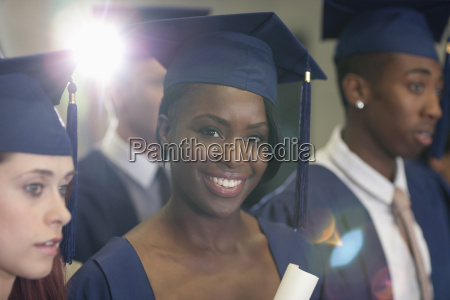 portrait of university student holding diploma