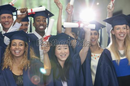 smiling university students standing in corridor