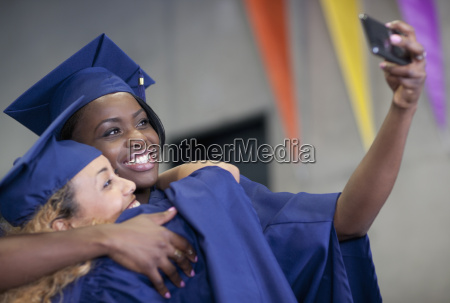 two smiling female students taking selfie
