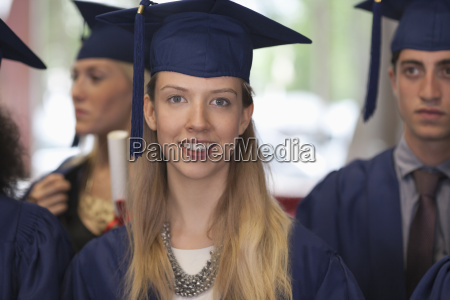 female student in graduation clothes smiling