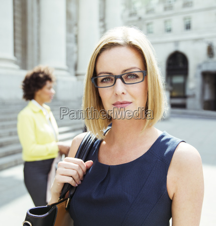 businesswoman standing in city