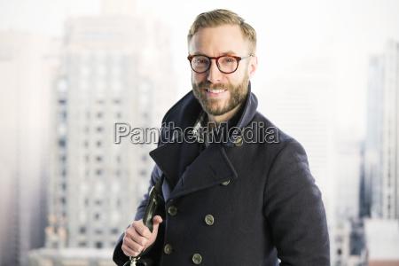 portrait of smiling businessman in urban