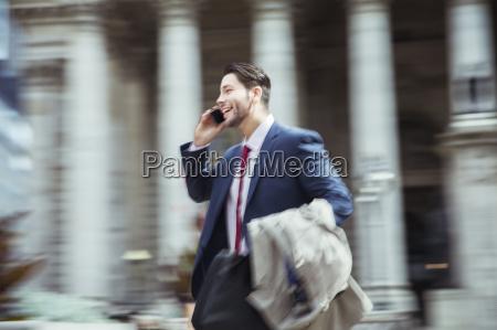 blurred view of businessman talking on
