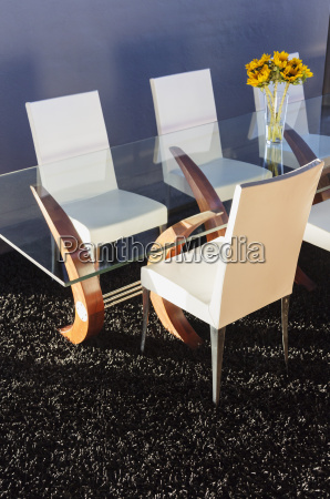 chairs at modern dining table