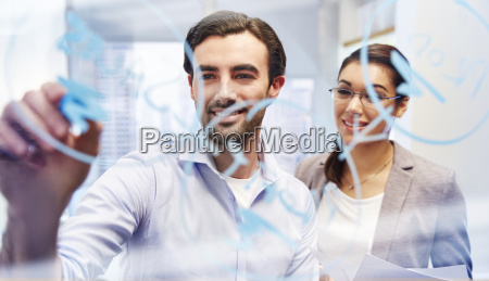office workers behind glass with blue
