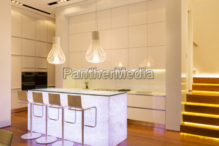 bar stools and lighting in modern