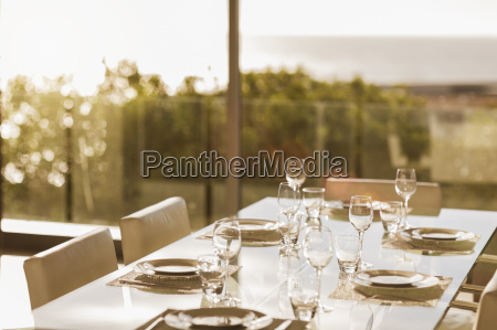 set table in modern dining room