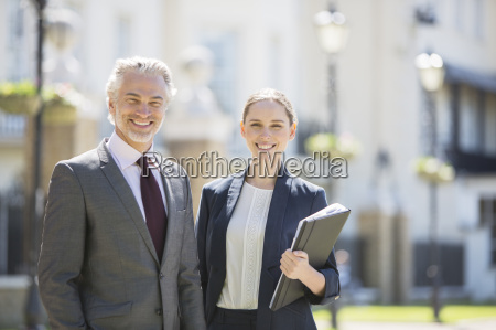 business people smiling outdoors