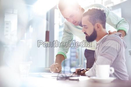 creative businessmen reviewing paperwork