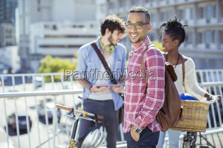 man smiling on city street