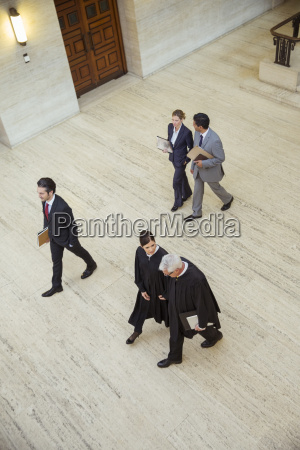 judges and lawyer walking through courthouse