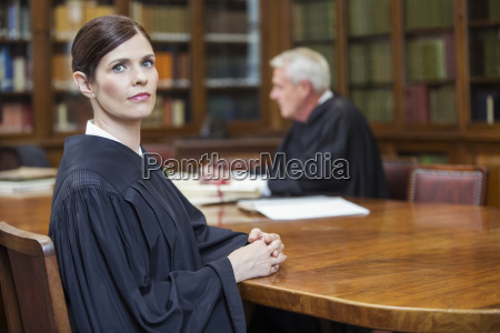 lawyer sitting at meeting table in