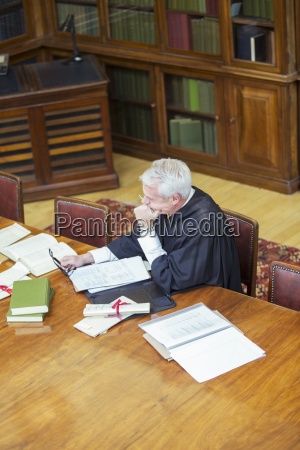 judge doing research in courthouse