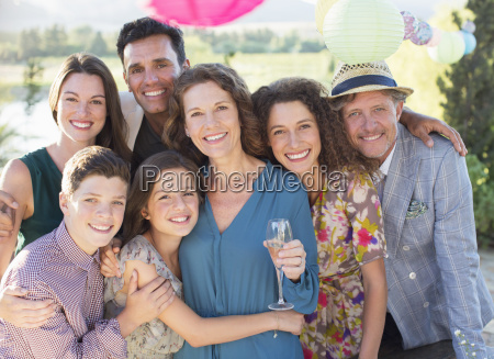 family hugging outdoors