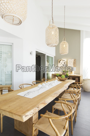 lanterns hanging over wooden table