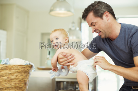 father checking babys diaper