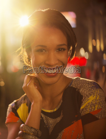 woman smiling on city street at