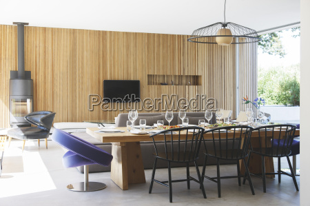 dining table sofas and television in