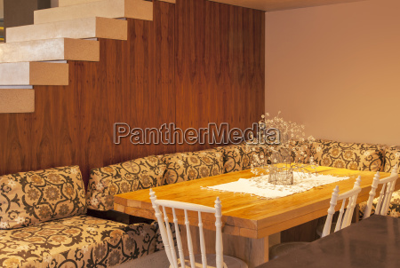 sofa surrounding dining room table in