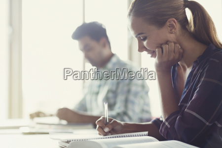 adult education student doing homework in