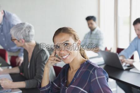 portrait confident adult education student in