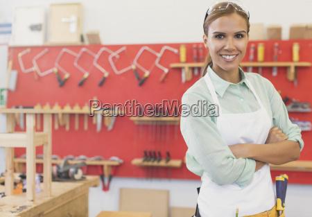 portrait confident carpenter in workshop