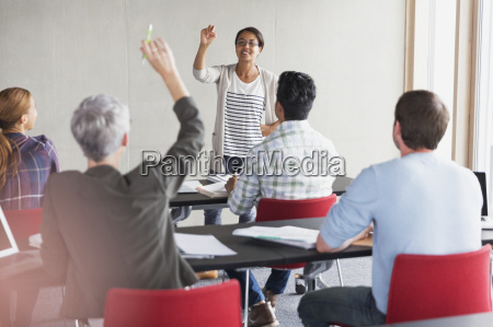 teacher calling on student with hand
