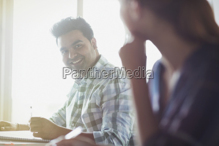 smiling students talking in adult education